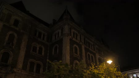 Old Building Facade At Night Stockvideo