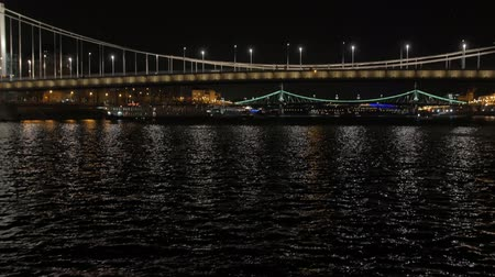 River Illuminated Bridge At Night Stockvideo