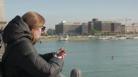 Girl With Phone On The Bridge Stock Footage