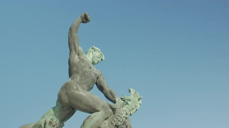 Man Fighting A Dragon Statue Stock Footage