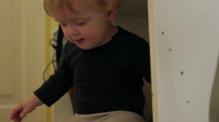 fool : Toddler Boy In Furniture Stock Footage
