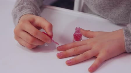 lak : Little Girl Polishes Nails Closeup