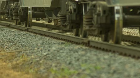 pneu : Freight train rides by rail, transports laden wagons Stock Footage