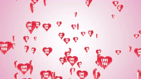 Beautiful 3D animation of heart balloons with shape of valentines heart flies against a pink background. This video can be used like greeting card for wedding, valentines day, intro or celebration. Stok Video