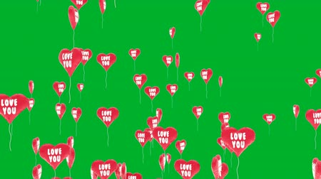 Beautiful 3D animation of heart balloons with shape of valentines heart flies against a green chroma key background. This video can be used like greeting card for wedding or valentines day intro. Stok Video