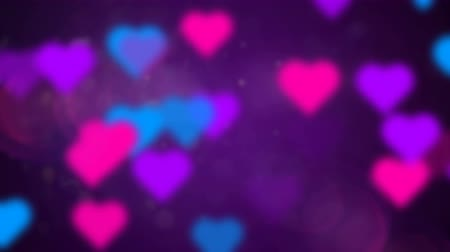 Beautiful 3D animation of abstract background with multicolored love hearts. This video can be used like backdrop for greeting card video for wedding, valentines day or celebration, seamless loop Stok Video