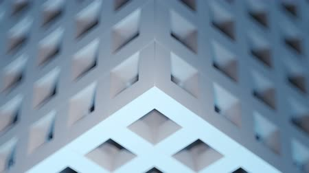 Beautiful seamless loop 3D animation of an abstract gray-blue cubic puzzle background