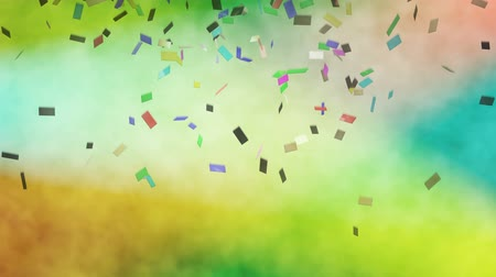 Abstract 3D animation of colorful shiny confetti which falling against the stage lights. Light of the green, yellow, red and blue spotlights colors smoke in various colors, seamless loop
