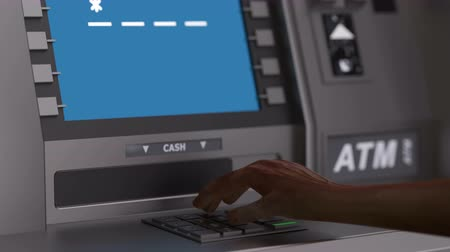 Rich customer inserts credit card in the atm and checks balance in the bank. After entering the pin code on display of atm a message appear that balance of account is one million dollars. Stok Video