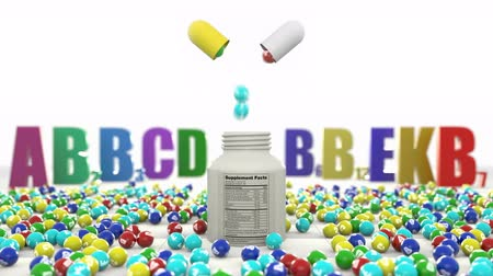 nutritional supplement : Granules with vitamins fall from the capsule pill into the plastic bottle. In the background is the designation of all vital vitamins A B2 B6 B12 C D E. Eating vitamin complex strengthens the body.