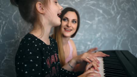 Child girl in piano class