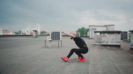 dancer guy dancing break dance on the roof