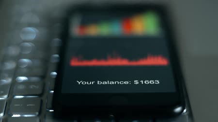 ekonomi : digits of account balance on the smartphone screen Stok Video