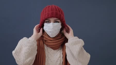 asistan : Sick girl puts on a mask coughs and sad