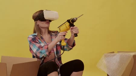 A young woman makes repairs using VR glasses.