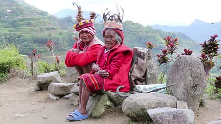 hill tribe : BANAUE, PHILIPPINES - JANUARY 24, 2014 : Unknown old ifugao people in national dress next to rice terraces. Ifugao - the people in the Philippines. Refers to the mountain peoples.