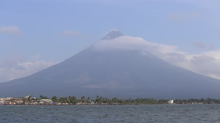 legazpi : Mayon Volcano in Legazpi, Philippines. Mayon Volcano is an active volcano and rising 2462 meters from the shores of the Gulf of Albay.