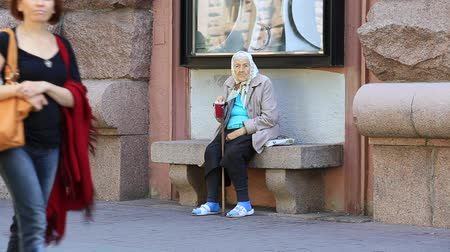 hobo : KIEV, UKRAINE - MAY 29, 2014: An unidentified homeless woman begging on the sidewalk near Independence Square in Kiev  Stock Footage