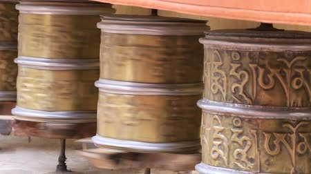 modlitba : Buddhist prayer wheels in Tibetan monastery with written mantra. India, Himalaya, Ladakh