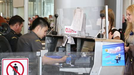 pas : BANGKOK, THAILAND - NOVEMBER 14, 2014: Airport passport control. People get their passports checked at Suvarnabhumi Airport