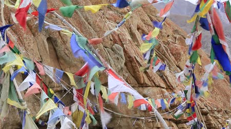 bodhnath : Plenty of colorful Buddhist prayer flags on the Stupa near Takthok gompa, Buddhist monastery in Ladakh, Jammu & Kashmir, India Stock Footage