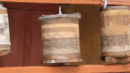 modlitba : Old wooden prayer wheel in Likir Gompa, Ladakh, India.