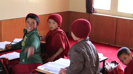 likir gompa : LIKIR, INDIA - SEPTEMBER 04 2014: Unidentified young Tibetan Buddhist students in class at the monastery Likir in Ladakh. Likir is the oldest and largest Buddhist monastery in Ladakh, India Stock Footage