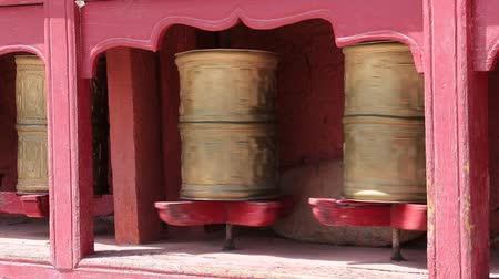 modlitba : Buddhist prayer wheels in Tiksey monastery with written mantra. India, Himalaya, Ladakh