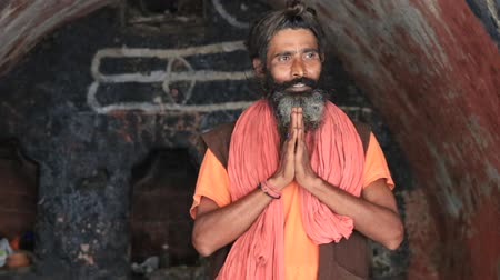 hobo : DEVPRAYAG, INDIA - OCTOBER 13, 2014 : Unidentified Indian sadhu (holy man) prays in the holy cave along the Ganges River. Poor Indians flock to Devprayag for charity.