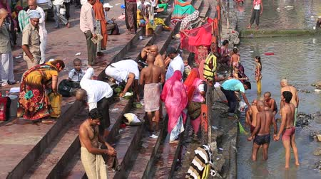 ayin : HARIDWAR, INDIA - OCTOBER 21, 2014: Unidentified Indian people at ritual washing in the sacred Ganges river. Haridwar - famous worship place in India