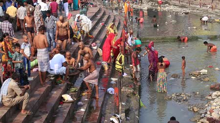 varanasi : HARIDWAR, INDIA - OCTOBER 21, 2014: Unidentified Indian people at ritual washing in the sacred Ganges river. Haridwar - famous worship place in India