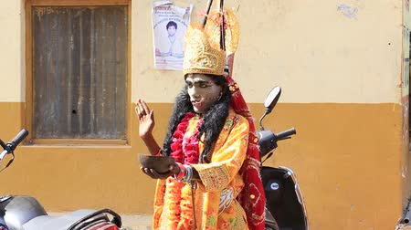 hobo : PUSHKAR, INDIA - OCTOBER 27, 2014: Unidentified Indian sadhu in mythological clothing blesses the people on the street. Pushkar - famous worship place in India