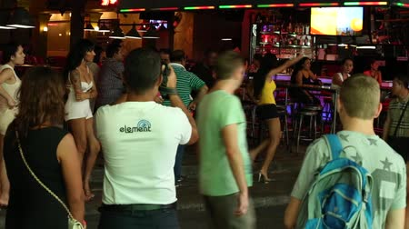 hooker : PATTAYA, THAILAND - NOVEMBER 15, 2014: Walking Street is red-light district with many restaurants, go-go bars and brothels, that draws people, primarily for night life and sexual entertainments