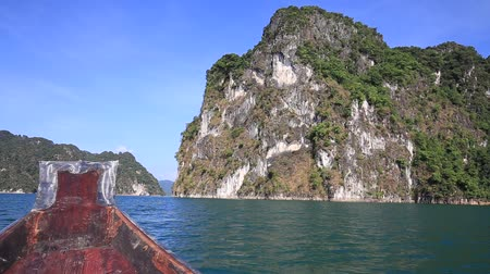 travel tropical : View sitting in a boat travel in lake at Khao Sok National Park, Surat Thani, Thailand.