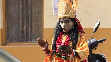 hobo : PUSHKAR INDIA OCTOBER 27 2014: Unidentified Indian sadhu in mythological clothing blesses the people on the street. Pushkar famous worship place in India