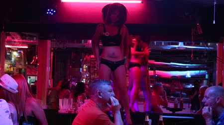 hooker : PATTAYA THAILAND NOVEMBER 15 2014: Walking Street is redlight district with many restaurants gogo bars and brothels that draws people primarily for night life and sexual entertainments Stock Footage