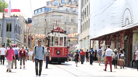 turecko : ISTANBUL, TURKEY - JULY 21, 2014: The Taksim Tunel Nostalgia Tram trundles along the istiklal street and crowded people at istiklal avenue Dostupné videozáznamy