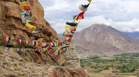 bodhnath : Plenty of colorful Buddhist prayer flags on the Stupa near Takthok gompa, Buddhist monastery in Ladakh, Jammu Kashmir, India Stock Footage