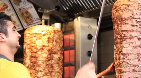 greek culture : ISTANBUL, TURKEY - AUGUST 03, 2015: Unidentified man prepares turkish kebab on the istiklal street in Istanbul, Turkey. Doner kebab is one of the most popular fast food in Turkey.