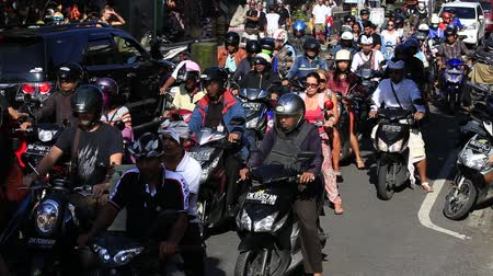 indonesia : UBUD, BALI, INDONESIA - MARCH 18, 2015: Traffic moves slowly along a busy road in Ubud