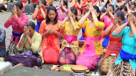 indonesia : UBUD, BALI, INDONESIA - MARCH 20, 2015: Unidentified Indonesian people celebrate Balinese New Year and the arrival of spring. Women praying at holy temple during the religious ceremony