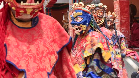 traditional ceremony : LAMAYURU, INDIA - JUNE 14, 2015: Tibetan lamas dressed in mystical mask dancing Tsam mystery dance in time of Yuru Kabgyat Buddhist festival at Lamayuru Gompa, Ladakh, North India Stock Footage
