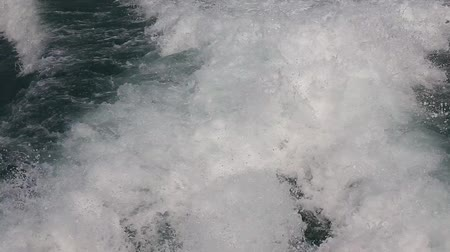 probudit : Blue ocean sea with fast yacht boat wake foam of prop wash