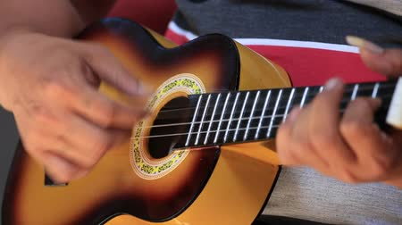 indonesia : Man play the guitar. Bali island, Ubud, Indonesia Stock Footage