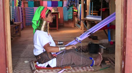 long neck karen : INLE LAKE, MYANMAR - JANUARY 14, 2016: Padaung Tribe woman poses for a photo. Padaung-Karen long-necked tribe women are minority of Myanmar