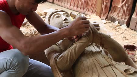 el sanatları : BAGAN. MYANMAR - JANUARY 22, 2016: Burmese man are making wooden souvenirs for tourists in Bagan, Myanmar. Wood Carving is a traditional handicraft in Myanmar