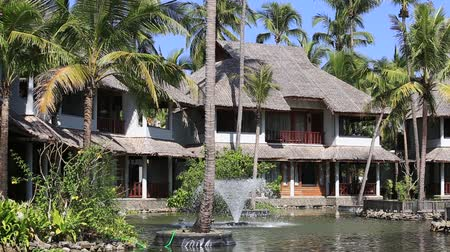 holiday villa : Fountain, pond, palm trees and the house next to the tropical beach. Ngapali, Myanmar