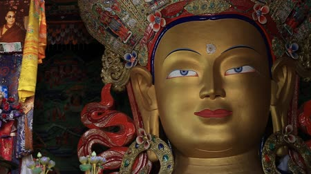 heaven and hell : Ladakh, INDIA - CIRCA 2015 Close up colorful sculpture of Maitreya buddha at Thiksey Monastery, Tibetan Buddhist monastery in Ladakh, India Stock Footage