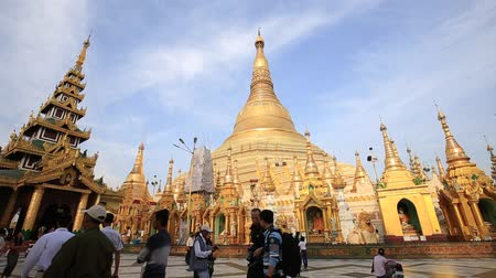 mianmar : YANGON, MYANMAR - JANUARY 9, 2016: Unidentified tourists and locals visit the Shwedagon Pagoda. Shwedagon Pagoda is the most sacred Buddhist pagoda for the Burmese
