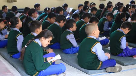 chant : DHARAMSALA, INDIA - SEPTEMBER 23, 2014: Unidentified Tibetan children chant mantras in Buddhist school in the Dharamsala near Dalai Lamas residence